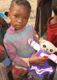 Child in Namibia receives Mother Bear Project bear