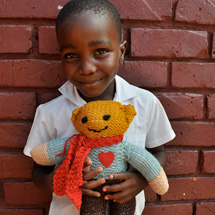 Child with Donated Bear